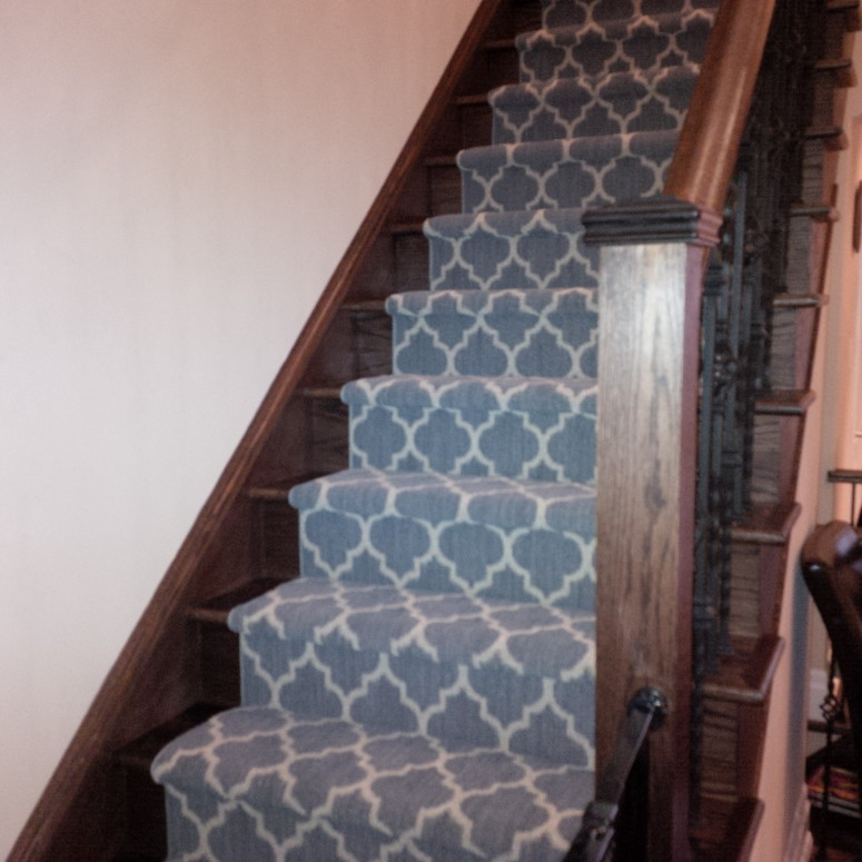 Blue carpet runner for stairs in geometric pattern