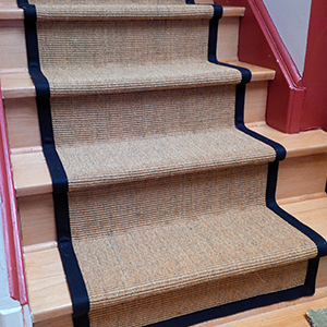 Sisal carpet runner with black boarder